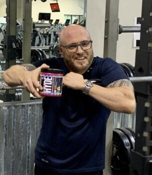 Best Fat Burning Pre Workout Supplement - me holding mr hyde container