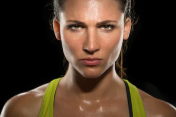 What Is The Best Low Calorie Protein Powder - female athlete sweating