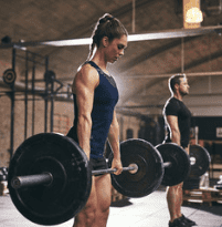 What is the best pre workout for women - lady lifting weight