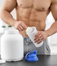 The Best Supplements For Muscle Growth - man making post workout powder
