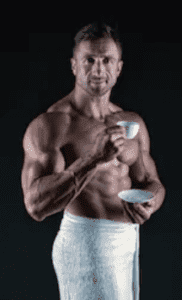Should I drink coffee before workout - muscle man drinking coffee