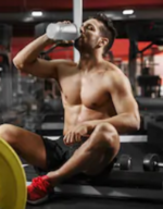 Pre Workout VS Post Workout Supplements- man drinking pre workout