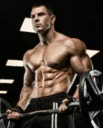 What Is The Best Pre Workout Without Caffeine - muscular guy picking up weights - guy doing bicep curls