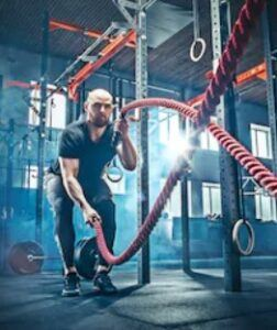 Energy endurance pre workout formula - man exercising with ropes