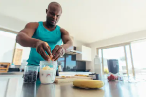 Pre Workout VS Post Workout Supplements - man making protein shake