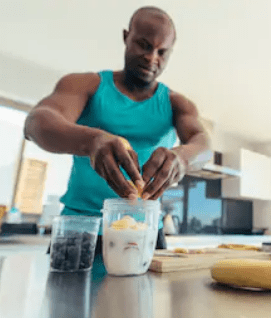 How and When To Take Protein Powder - man making protein shake