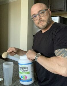 What Is The Best Natural Protein Powder - me mixing orgain organic protein powder