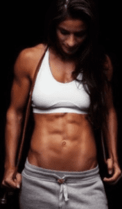 Crossfit and Pre Workout - woman with muscular stomach
