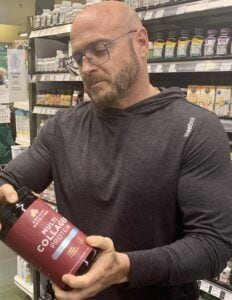 Ancient Nutrition Collagen Review - me looking at ancient nutrition ingredients