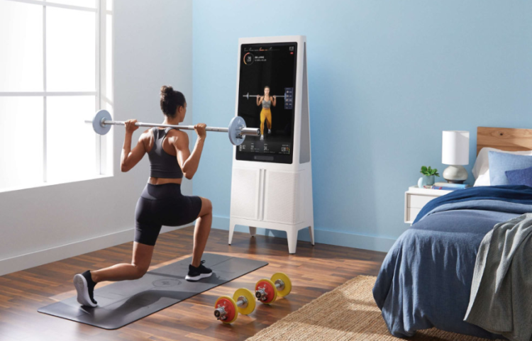 Tempo Home Gym Reviews - Tempo Home Gym Studio- lady working out in bedroom