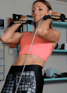The Total Gym Reviews - woman using total gym exercise machine