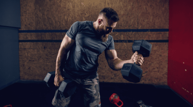 Dumbbell Sets For A Home Gym - man using dumbbells for home gym
