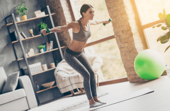Dumbbell Sets For A Home Gym - woman using dumbbells at home