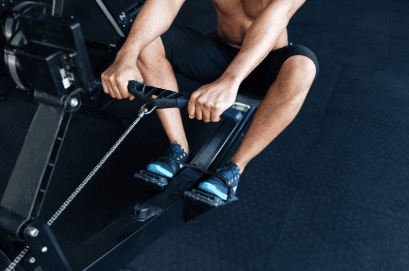 Rowing Machine Workouts for Weight Loss - Man using rowing machine