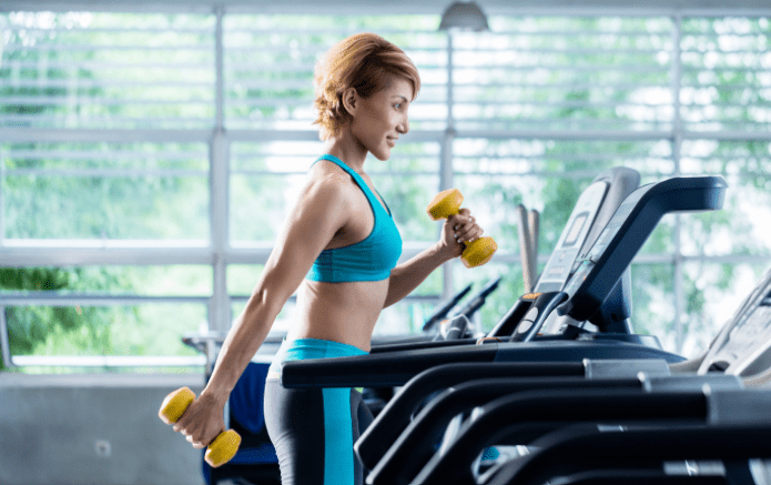 Best Treadmill Workouts for Weight Loss - treadmill training with dumbbells