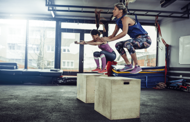 What Is A Plyo Box - Women jumping on a plyo box