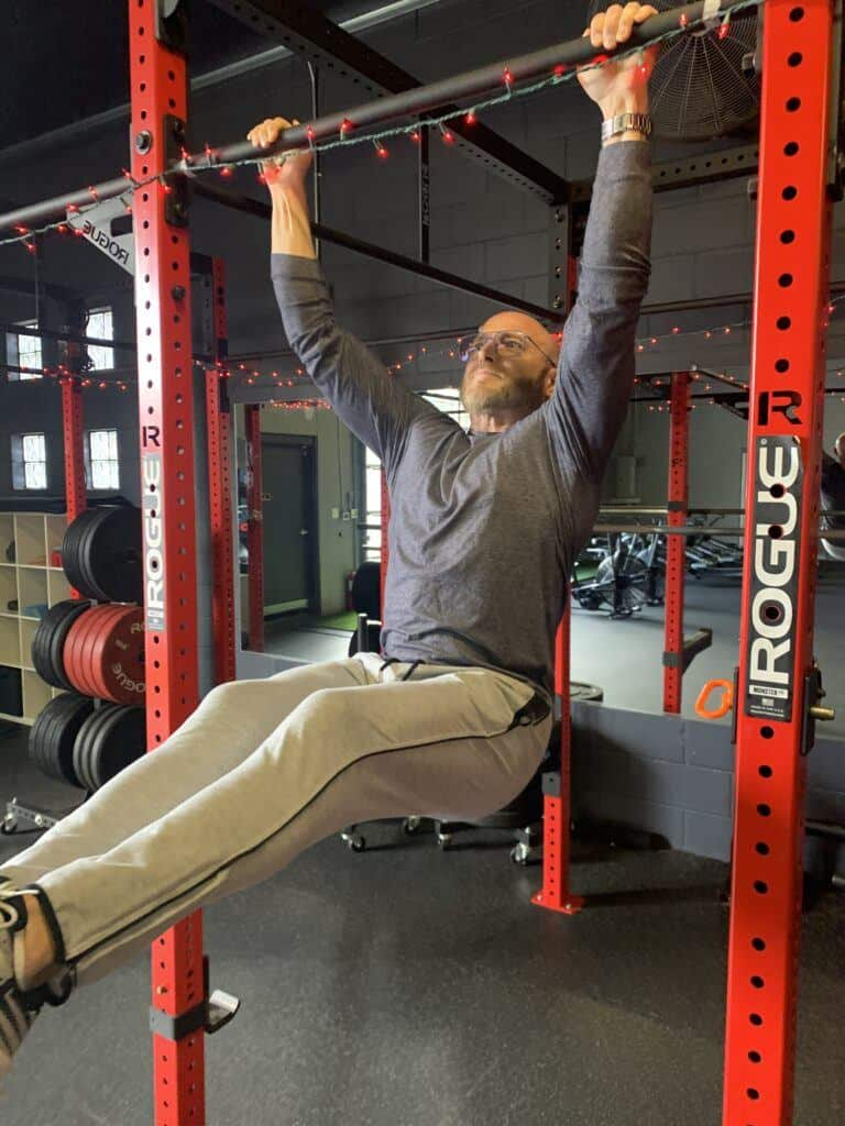 Best Rogue Fitness Equipment Reviews - me hanging from Rogue equipment