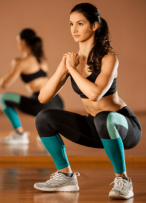 what is a squat exercise - woman doing bodyweight exercise