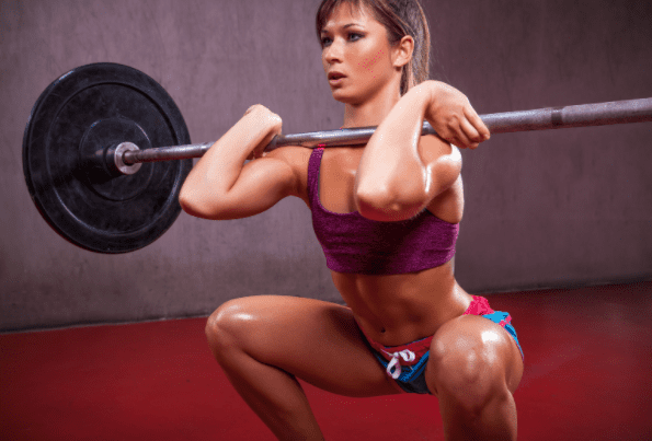 what is a squat exercise - woman doing front squats