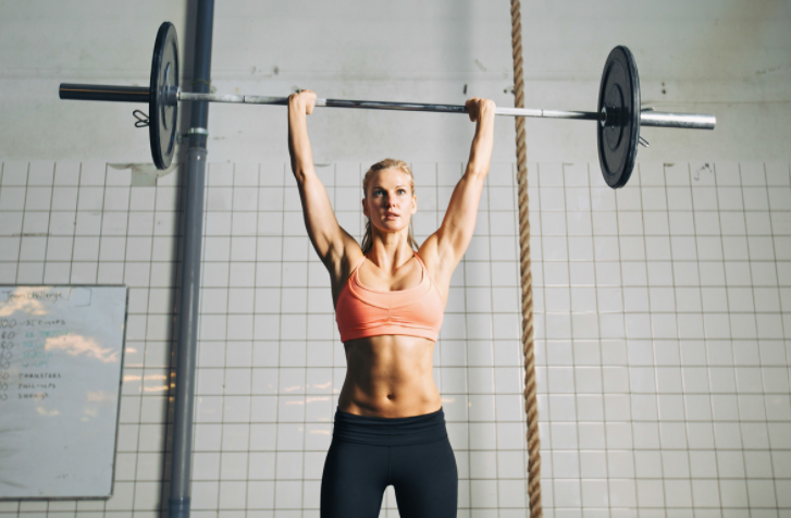 Crossfit workout routines - woman doing military press