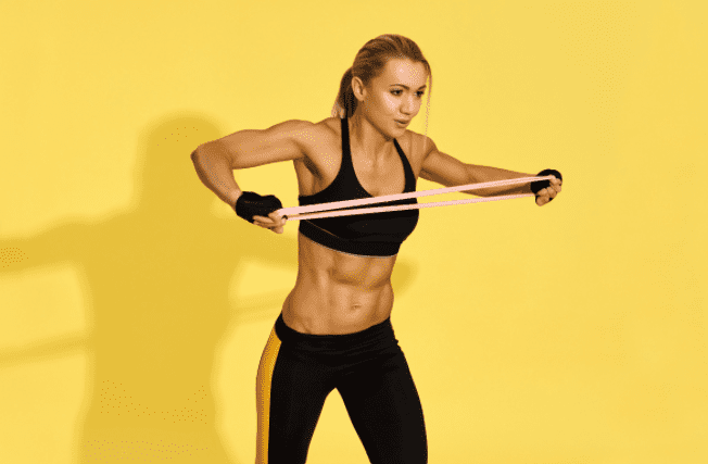 Exercise Bands Workout - woman doing resistance band pulls apart