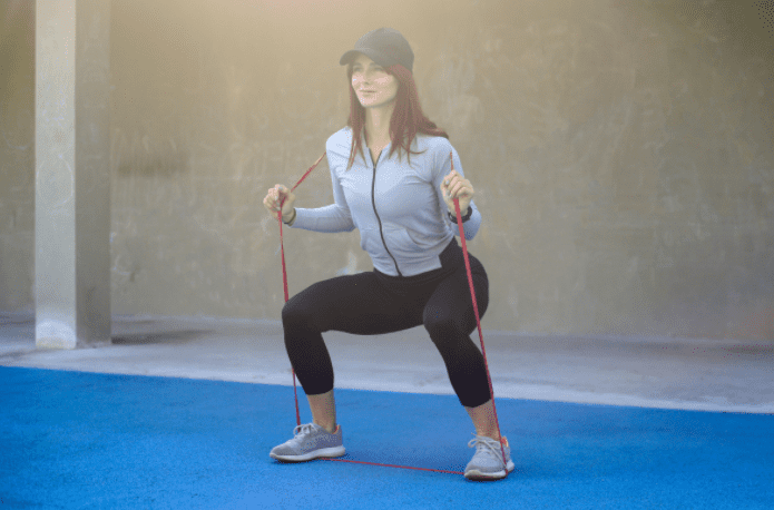 Best Exercise Bands Workout - woman doing resistance band squats