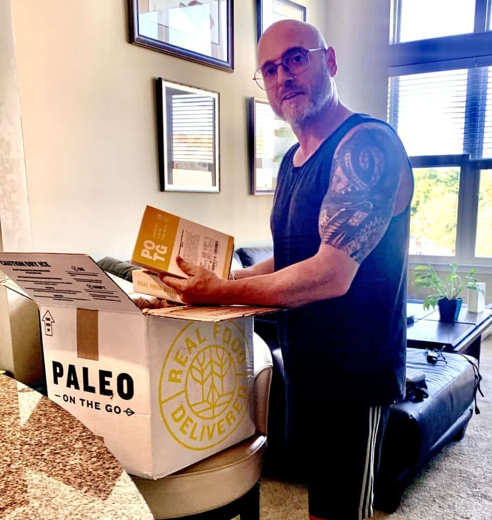 Paleo on the go review - me opening paleo food box