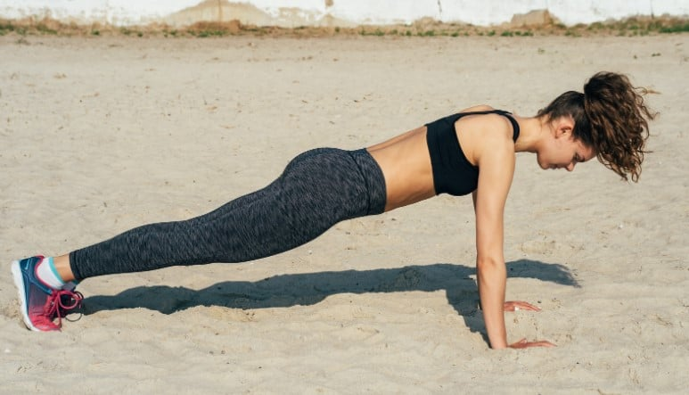 What Muscles Do Pull Up Exercises Work - Woman doing push ups