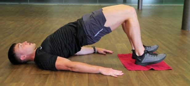 What Is The Best Home Workout Routine - Towel hamstring curls