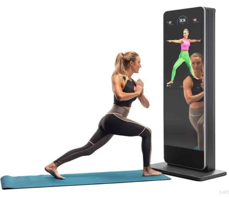 NordicTrack Vault review - Woman doing yoga with NordicTrack Vault