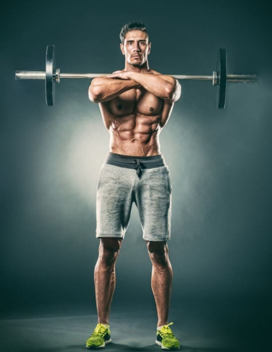 how to do a front squat - man doing front squat standing position